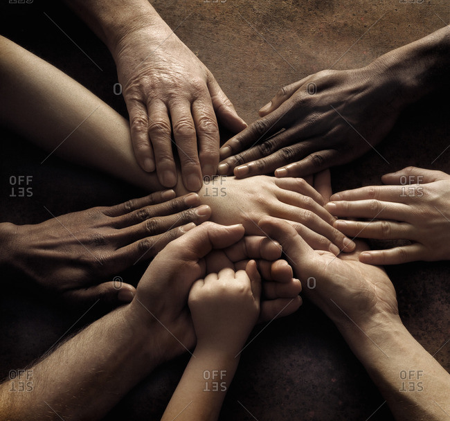 Close-up of people's hands holding together