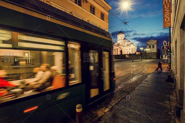 Finland, Helsinki, Kronohagen, Cable car at night, Helsinki Lutheran Cathedral in background