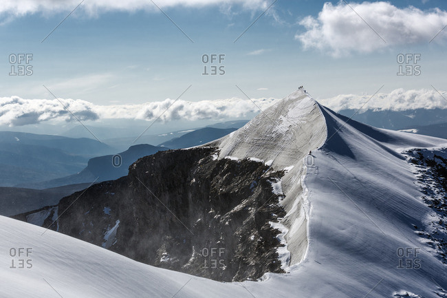 Sweden, Lapland, Snowy ridge and peak of Kebnekaise mountain