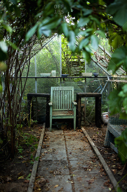 Sweden, Wooden chair and tables in greenhouse