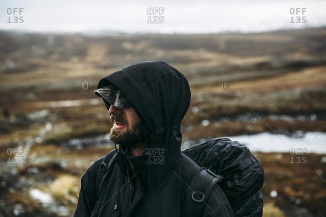 Sweden, Sylama, Jamtland, Portrait of backpacker in hooded jacket