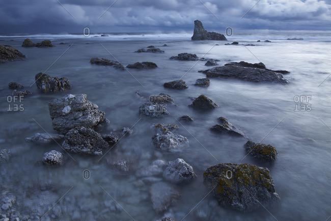 Sweden, Gotland, Faro, Digerhuvud, Storm clouds
