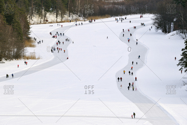 Lidingo, Uppland, Sweden - January 24, 2010: Elevated view of people having walk in winter