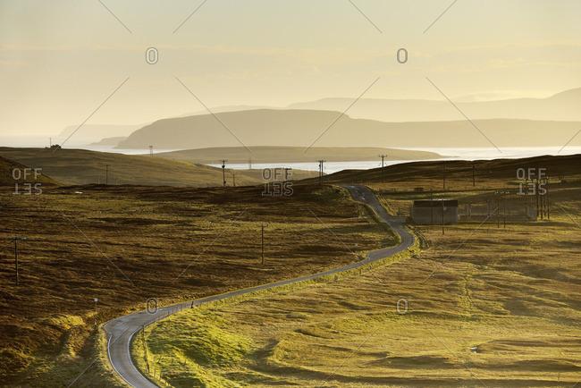 UK, Scotland, Shetland, Yell, Gutcher, Power lines along road