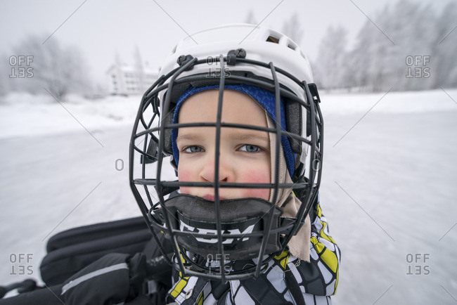 Finland, Pohjois-Pohjanmaa, Oulu, Portrait of boy in ice hockey helmet