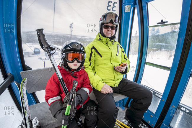 Finland, Lapland, Levi, Grandfather and grandson in ski lift