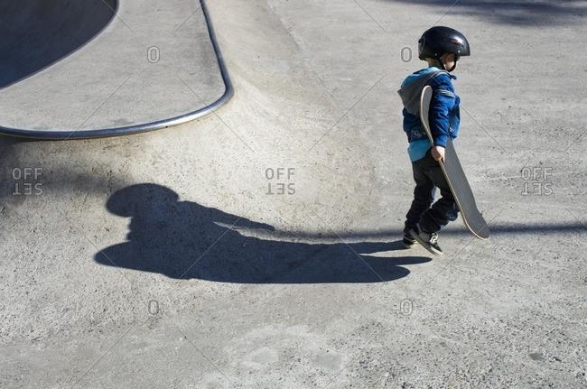 Finland, Uusimaa, Helsinki, Boy holding skateboard