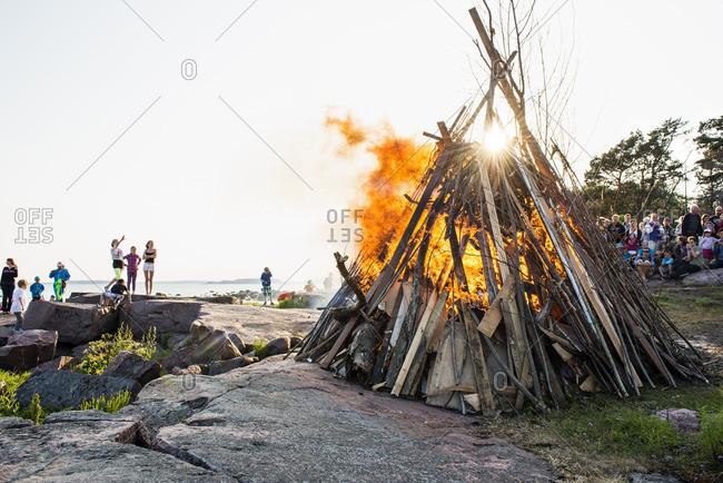 Drumso, Helsingfors, Finland - June 21, 2013: Finland, Helsinki, Drumso, People enjoying traditional bonfire
