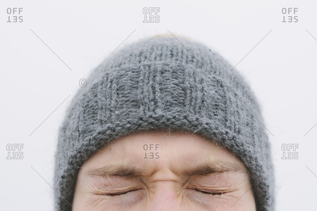 Finland, Helsingfors, High section shot of young man's face with eyes closed tight