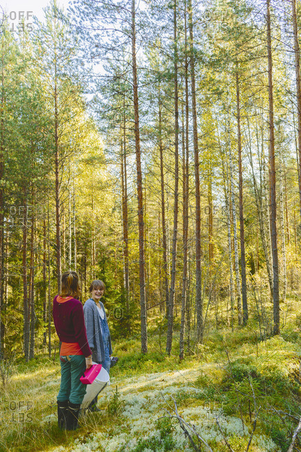 Finland, Etela-Savo, Huttula, Two women picking mushrooms in forest