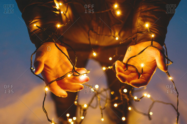 Finland, Jyvaskyla, Saakoski, Young man holding Christmas lights