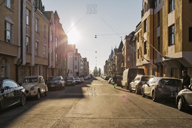 Finland, Helsinki, View along sunlit street