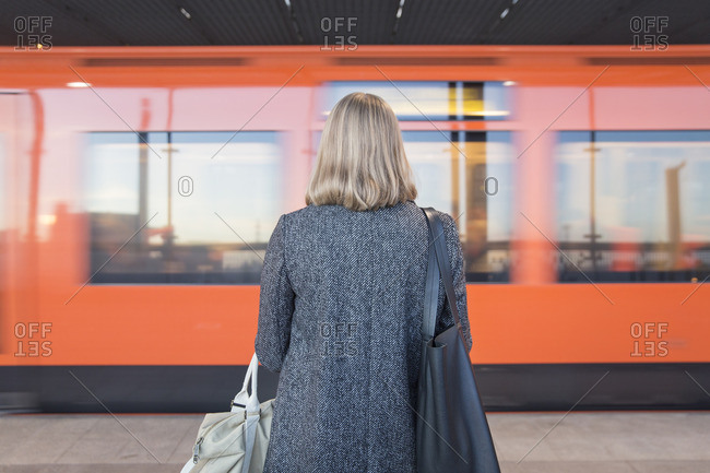 Finland, Uusimaa, Helsinki, Rear view of woman standing on Helsinki Metro