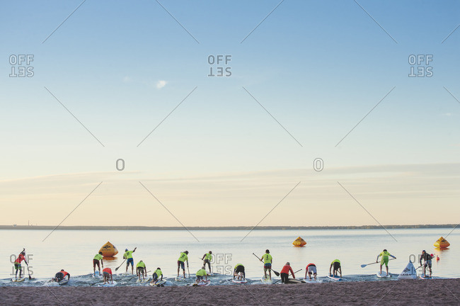 Eura, Varsinais-Suomi, Finland - July 4, 2014: Finland, Varsinais-Suomi, Eura, Paddlers by shore during race