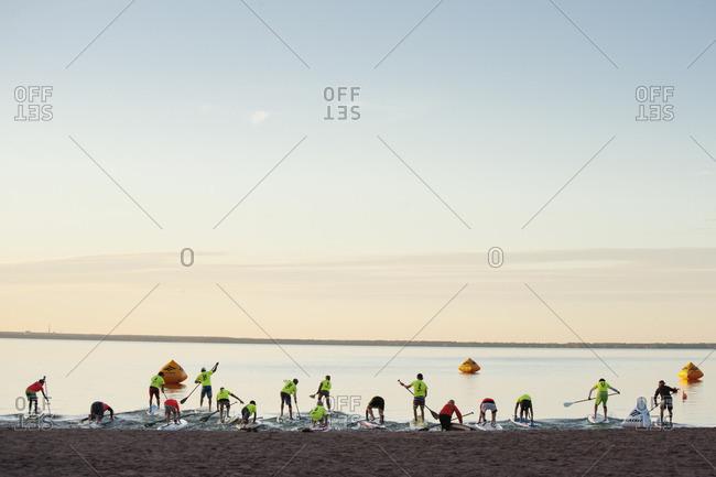 Satakunda, Eura, Varsinais-Suomi, Finland - July 4, 2014: Finland, Varsinais-Suomi, Satakunda, Eura, Paddleboarders entering lake