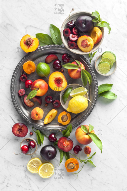 Overhead view of a variety of fruits on an antique tray