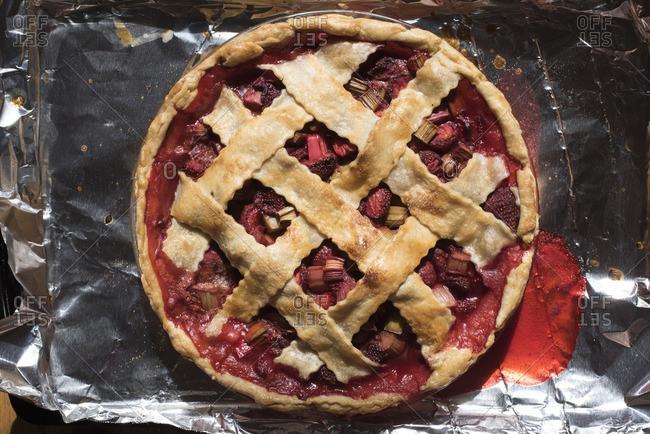 Lattice topped strawberry rhubarb pie close-up