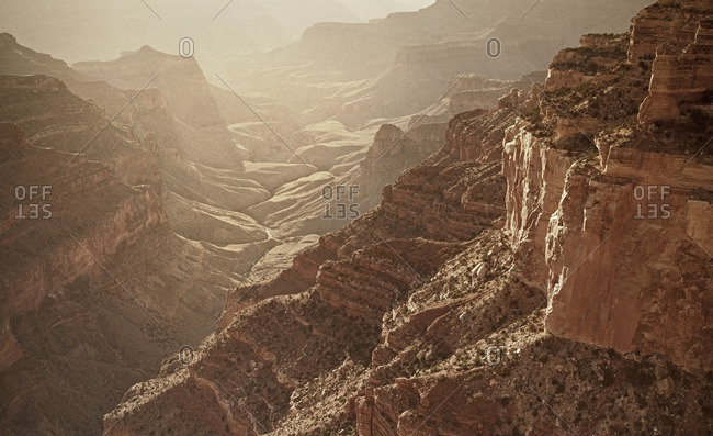 Aerial view of a rugged sunlit canyon