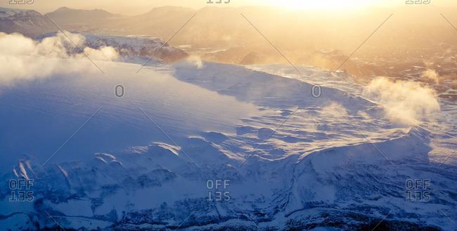 Sunset over a snowy mountain vista