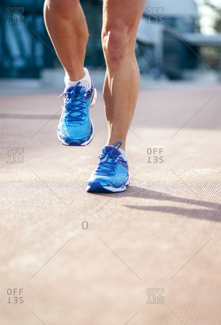 Athletic woman\'s feet on a race track