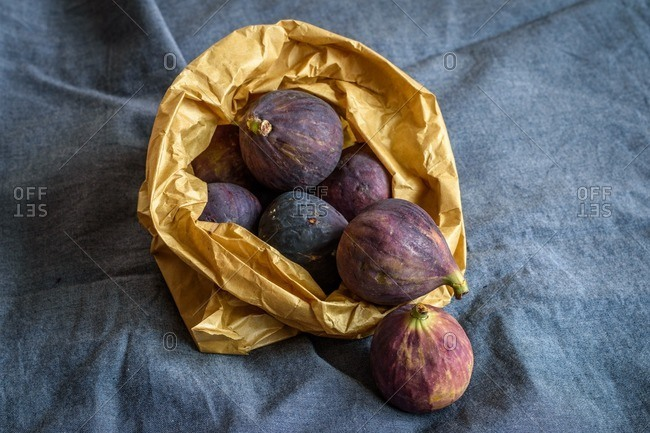 A bag full of fresh, whole figs