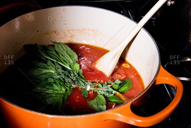 Basil leaves in tomato sauce