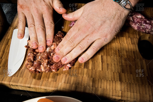 Hand forming raw sausage
