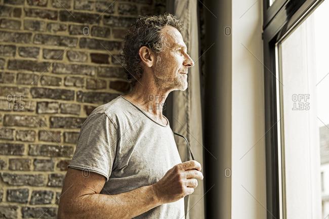 Man looking through window - Offset