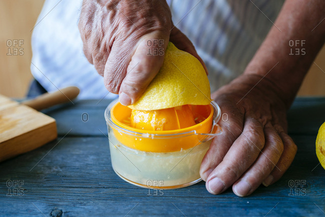 Close-up of hands squeezing lemon
