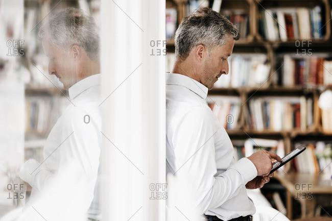 Businessman reading e-book