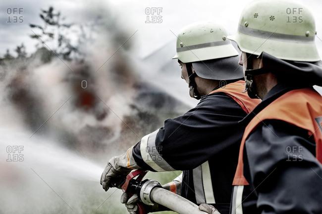 Fire brigade extinguishing fire - Offset