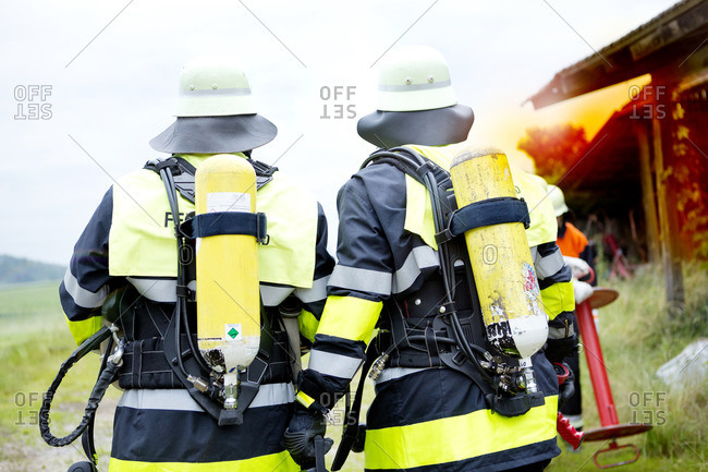 Back view of two firefighters