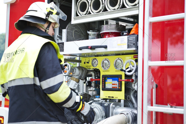 Firefighter at fire engine - Offset
