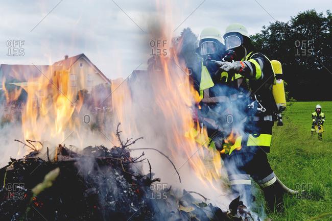 Fire brigade standing at fire