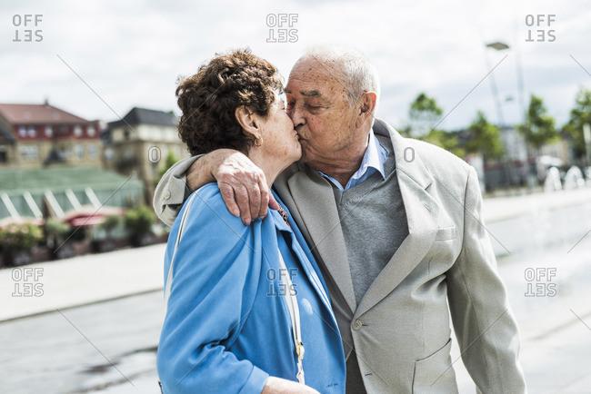 Senior man kissing his wife