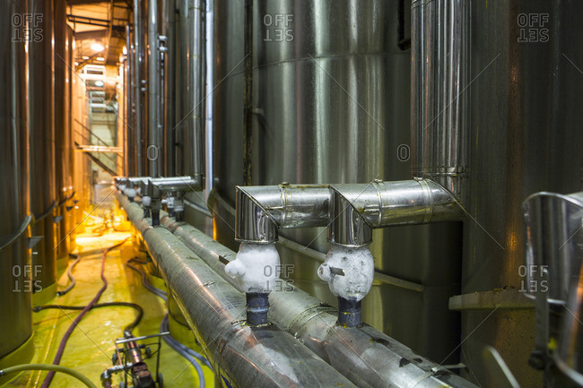 Pipework of wine tanks in winery