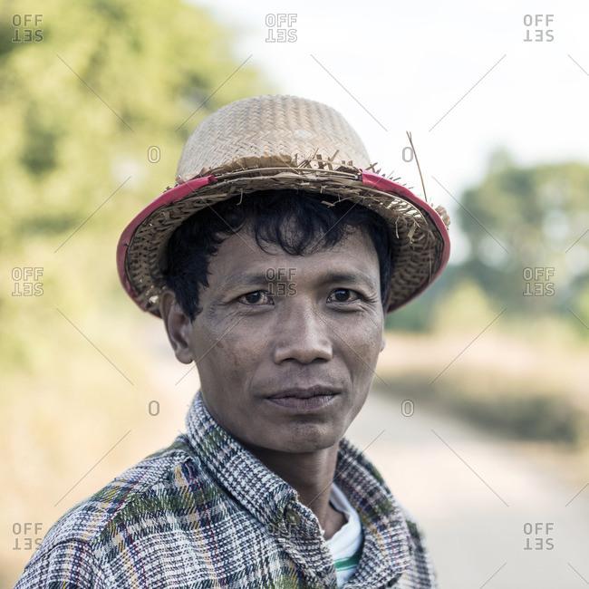 Bagan, Myanmar - December 6, 2013: Portrait of local farmer wearing traditional clothing in Bagan, Myanmar
