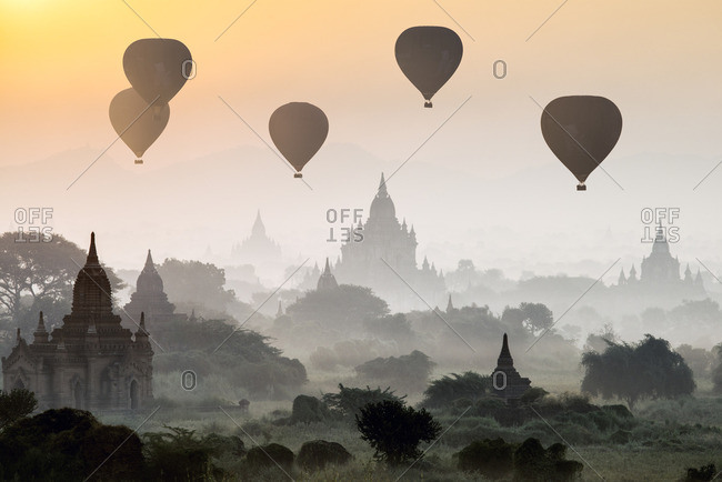 Hot air balloons flying over the ancient temples of Bagan, Myanmar