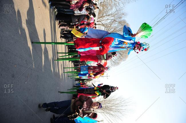 Beijing, China - February 9, 2009: Spectators watch traditional Stilt Dancers at Lantern Festival
