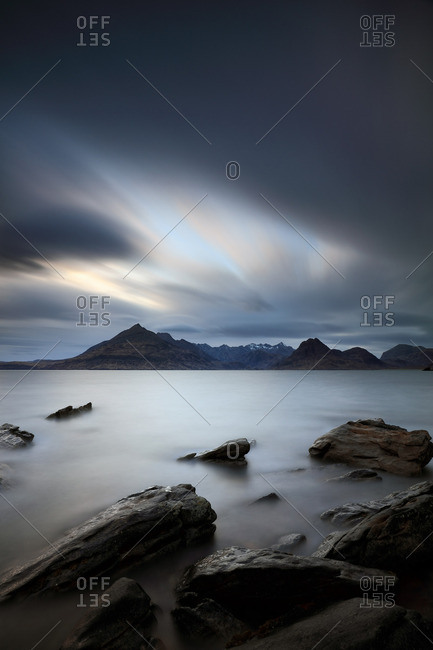 Dramatic evening sky and rocks in the sea at Elgol, Scotland