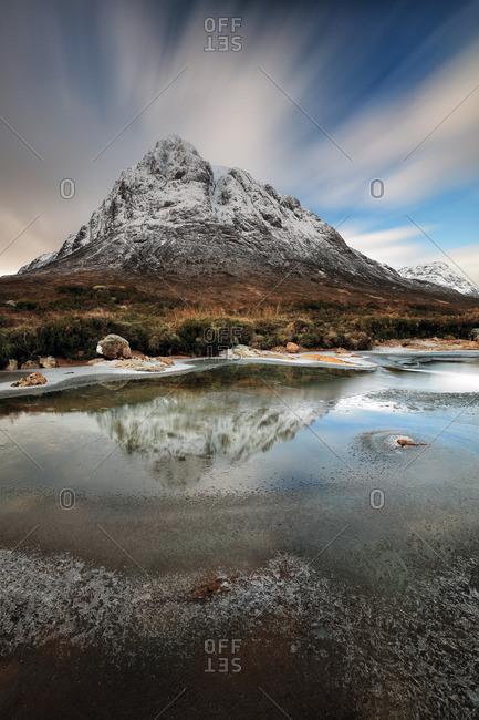 Streaked sky above snowy peak in Scottish Highlands