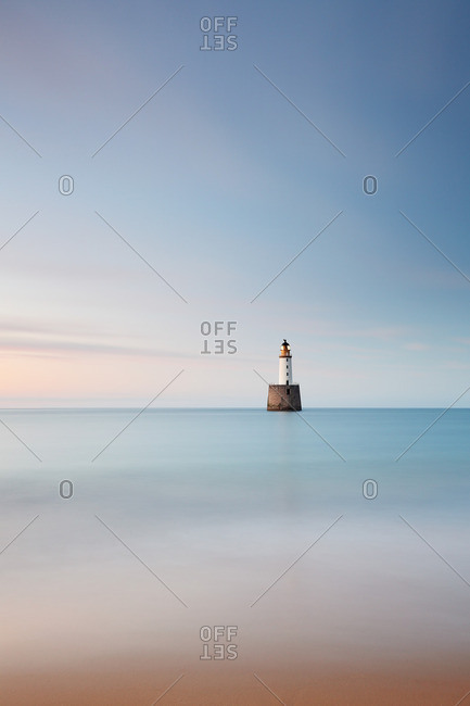 Rattray Head Lighthouse in the North Sea at dusk, Scotland