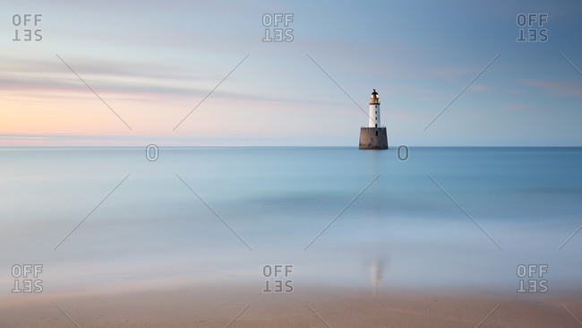Rattray Head beach and lighthouse in the North Sea at dusk, Scotland