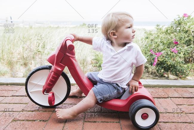 Boy on trike near beach