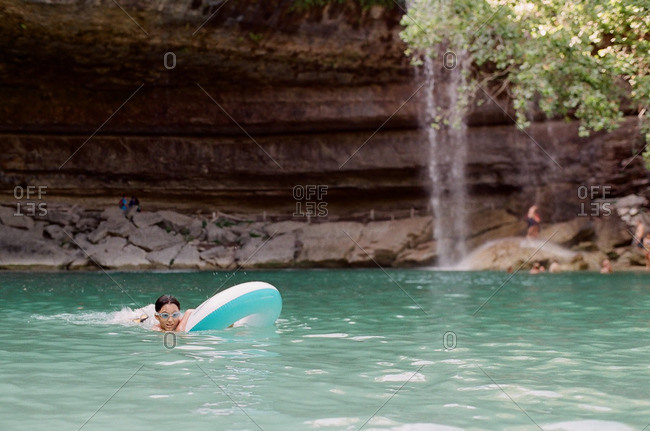 Boy on tube in river