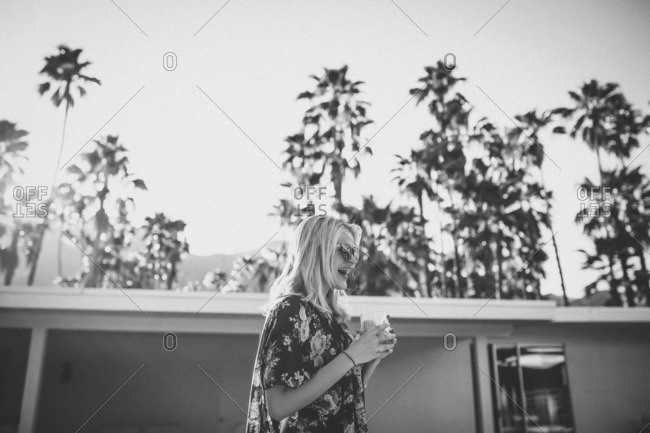 Woman in backyard with wine glass in Palm Springs, California