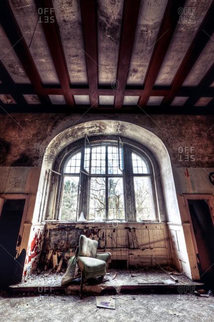 Large window in a decaying sanatorium