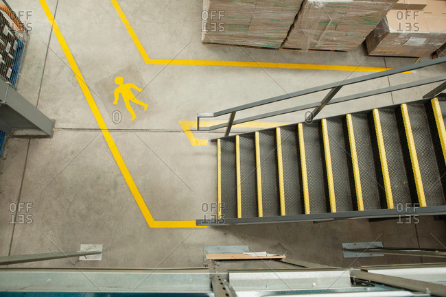 Steps and yellow lines in warehouse, elevated view