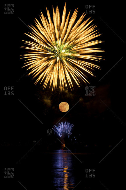 Firework in the sky above the moon