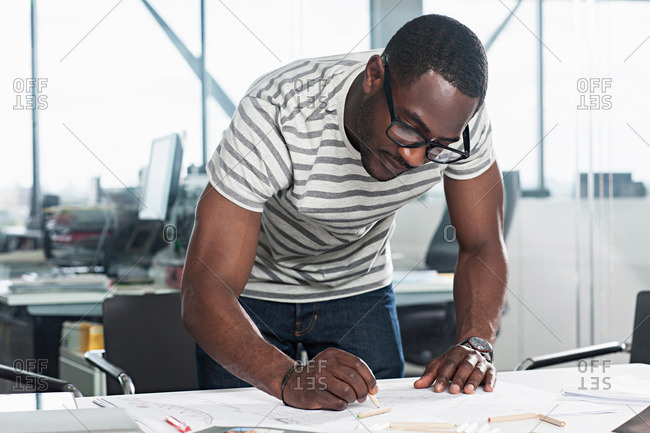 Man drawing plans in office